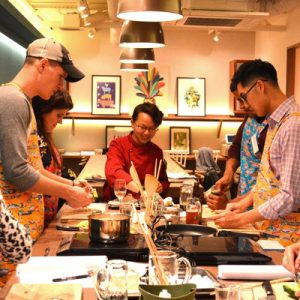 participants of a cooking class in the Taste of Okinawa studio
