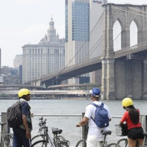 cyclists marveling at Brooklyn Bridge