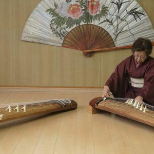two women in kimonos playing the koto