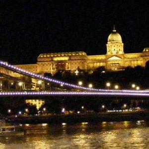 a bridge in Budapest illuminated at night