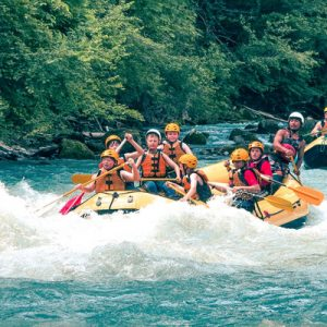 groups of tourists river rafting