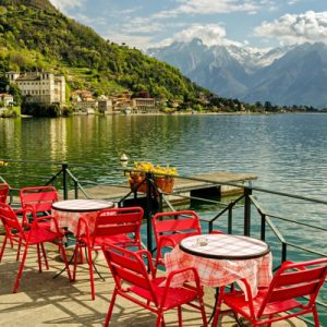 red chairs and dining table overlooking lake como